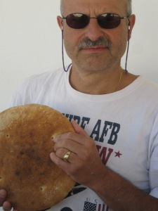 My husband, seriously enjoying freshly made Spanish bread!