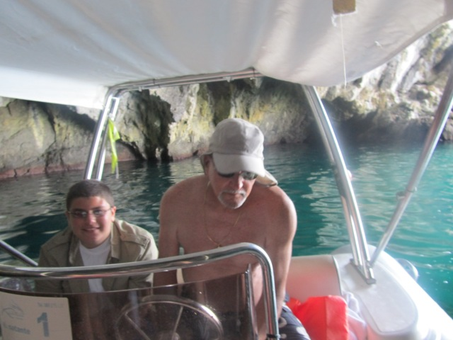 Captain Gary piloting the boat into a large cave