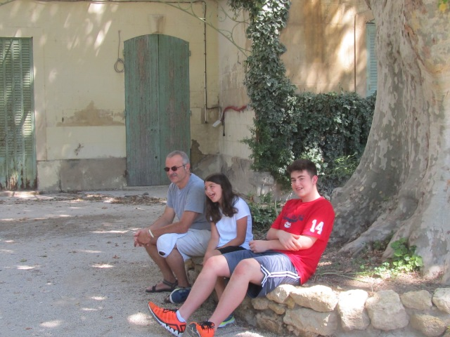 My family in a quiet park in our home exchange village in Provence, last summer 2013